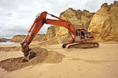Works at the beach. Replacing sand with an excavator Royalty Free Stock Image