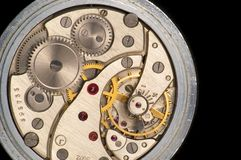 Works of a clock. On black Royalty Free Stock Photos