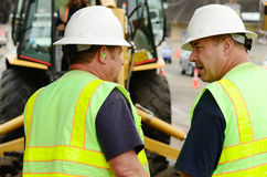 Works Command. Public works supervisors at a exchavation hole to repair a 12 inch water main failure Stock Image