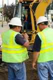 Works Command. Public works supervisors at a exchavation hole to repair a 12 inch water main failure Royalty Free Stock Photo
