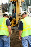 Works Command. Public works supervisors at a exchavation hole to repair a 12 inch water main failure Stock Images