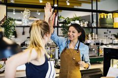 Works giving high five to each other royalty free stock photography