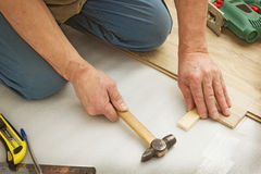 Works on laying laminate panels Royalty Free Stock Images