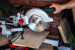 Works miter saw. The red line of the laser target pointer in the place of the future cut royalty free stock images