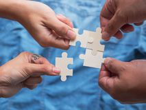 The works requires cooperation and mutual help to accomplish. The works requires cooperation and mutual help to accomplish, just like puzzles royalty free stock photo