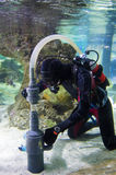 Works under water. A diver performs special work underwater Royalty Free Stock Images