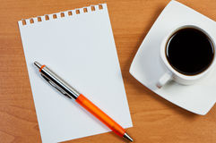 Worksheet with pen and coffee. Royalty Free Stock Photo