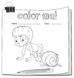 A worksheet showing a boy and a snail Stock Photos