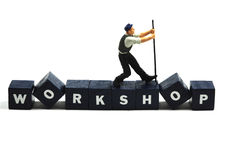 Workshop. A working man on the word workshop Royalty Free Stock Photos