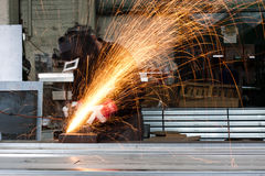 Workshop. Sparks flying during grinding in a metal workshop Royalty Free Stock Photography