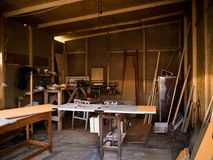 Workshop. With many tools and wood boards Royalty Free Stock Images