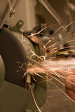 Workshop. Metal bar being grind ed and many sparks are flying Stock Photos