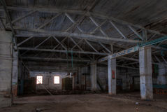 Workshop of abandoned factory. Dilapidated workshop of the abandoned factory Stock Image