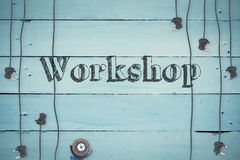 Workshop against plugs on wooden background Stock Photos