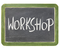 Workshop blackboard sign. Workshop word in white chalk handwriting on a vintage slate blackboard, isolated on white Royalty Free Stock Photos