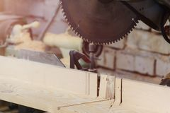 Workshop of Cabinetmaker Carpenter - Working with Wood. Electric Backsaw with Copyspace. stock photo