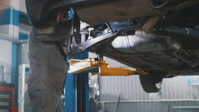 Workshop car service - the collapse of convergence - process repairing Stock Photos