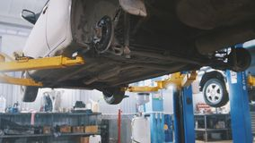 Workshop car service - the collapse of convergence - process repairing Stock Images