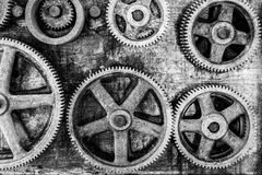 Workshop. Closeup image of rusted gears hanging on the wall of an abandoned workshop Royalty Free Stock Photos