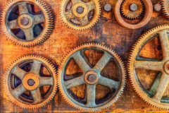Workshop. Closeup image of rusted gears hanging on the wall of an abandoned workshop Royalty Free Stock Photography