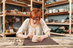 Workshop of craftsman pottery, pot decorating Stock Photos