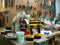 Workshop: disorganized bench. Disorganized tools on workshop bench Stock Photo