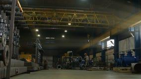 Workshop employees weld construction against equipment crane stock video