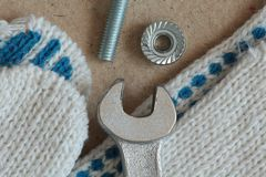 Workshop fitters tools. Workplace mechanic wrench gloves bolt and nut macro shot stock images