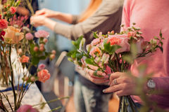 Workshop florist, making bouquets and flower arrangements. Woman collecting a bouquet of roses. Soft focus Royalty Free Stock Image