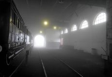 Workshop in the Fog. An old steam Locomotive Workshop still in use Royalty Free Stock Images