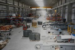Workshop hall. A view of a huge hall of a workshop with different industrial equipment on the floor Stock Images