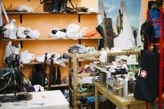 Workshop interior repair shop and shoe creation stock photos
