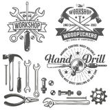 Workshop logo. Vintage emblem repair workshop and tool shop in vintage style. Working tools. Text on a separate layer - easy to replace Stock Photography