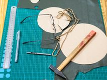 Spectacles and tools to produce the pouch royalty free stock photography