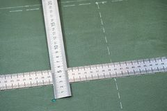 Rulers on surface of leather with drawn pattern royalty free stock photos
