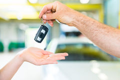 Workshop mechanic handing car to customer Royalty Free Stock Photo