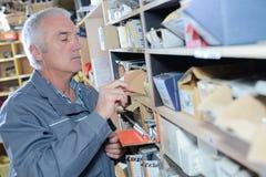 Workshop mechanics looking screws royalty free stock images