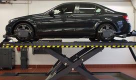 Workshop. Modern car on huge jack Stock Photography