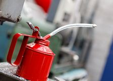 Workshop Oil Can. A red oil can in an engineering workshop Royalty Free Stock Photo