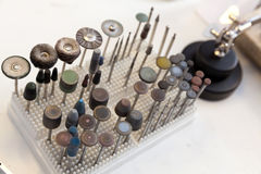 Workshop polishing tools. Jeweler at work, crafting in a jewelery workshop Stock Images