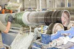 Workshop production. A fiber reinforced pipe is in production in workshop Stock Photos