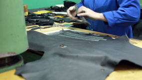 Workshop for production of shoes. Cutting leather stock video
