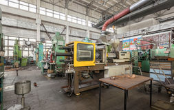 Workshop for production of thermoplastic parts. Injection molding plastic machine Stock Photography