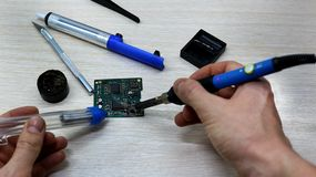 Workshop on repair of household appliances, electronics and processors. soldering Board soldering iron, re-soldering chips, stock photos
