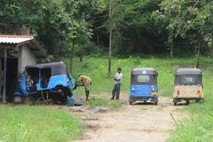 Workshop repair of tricycles on the outskirts of the city. Stock Images