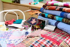 Workshop of a seamstress with fabric and quilting Stock Photos