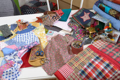 Workshop of a seamstress with fabric and quilting. Workshop of a seamstress with fabric and patchwork Royalty Free Stock Images