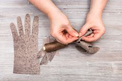 Designer stitches the genuine leather gloves. Workshop on sewing gloves - designer stitches the genuine leather gloves Stock Images