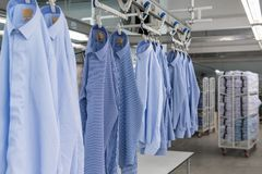 Workshop in sewing shirts in a textile factory stock images