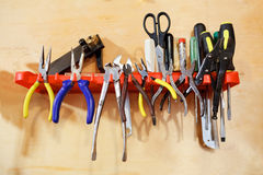Workshop tools pliers on wall stand. Royalty Free Stock Photo